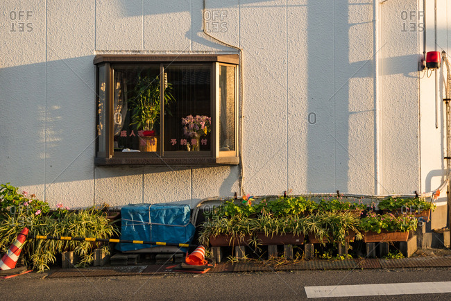 Osaka, Japan - December 10, 2016: Street window with shadows