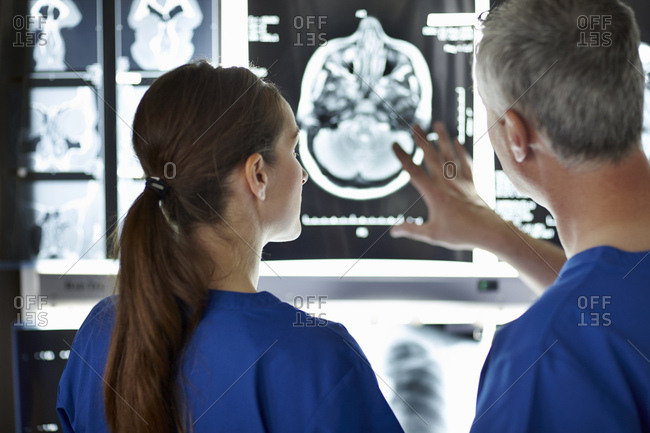 Radiologists looking at brain scans