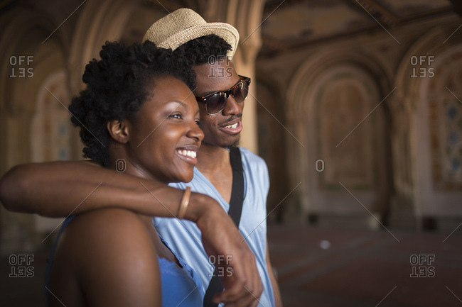 Young couple strolling in Bethesda Terrace arcade, Central Park, New York City, USA