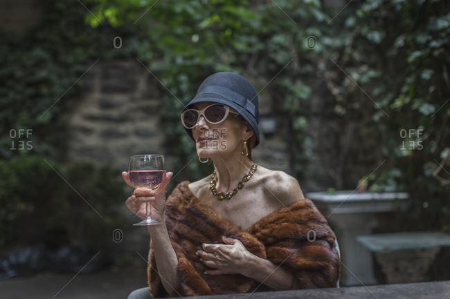 Fashionable senior woman in garden