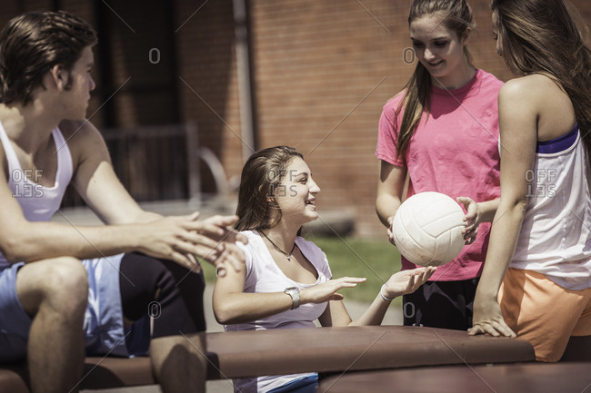 High school volleyball students team talking outside high school