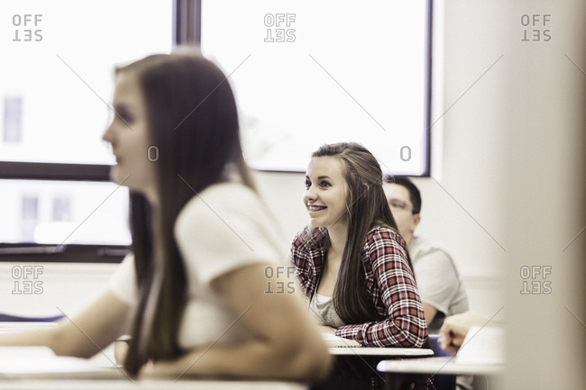 High school students listening to lesson in high school classroom