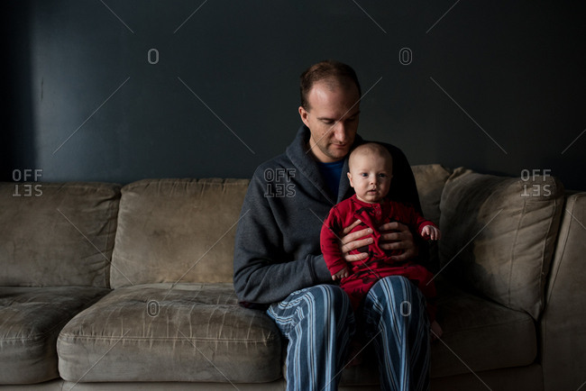Dad balancing baby on his leg