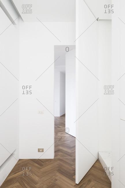 Door in empty home with hardwood floors