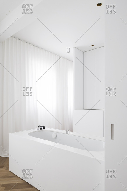 Bath area in a bright white bathroom