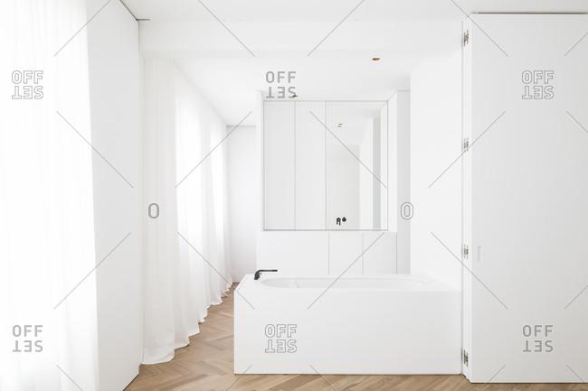 Bath area in hardwood floor bathroom