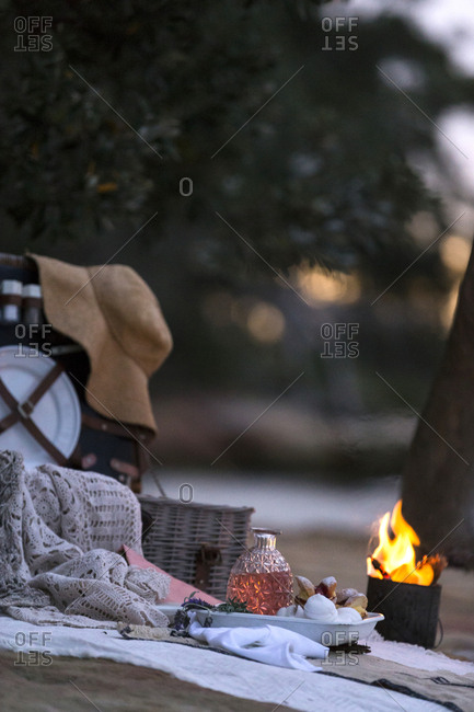 Picnic accessories on beach with campfire