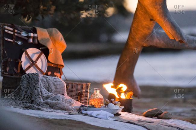 Beachfront picnic scene by firelight