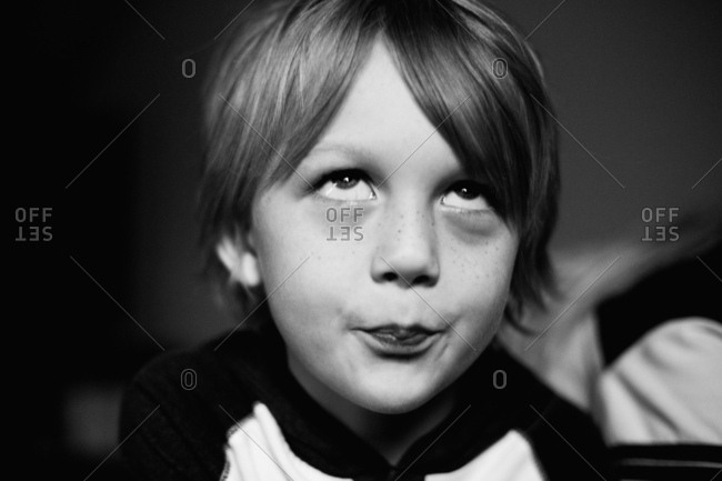 Boy rolling his eyes in portrait