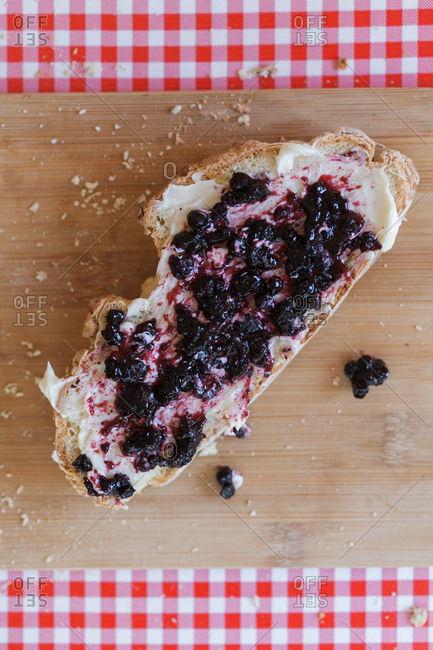 Bread with butter and blueberry jam