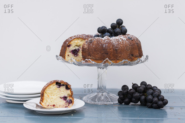 Concord grape bundt cake sliced with plates