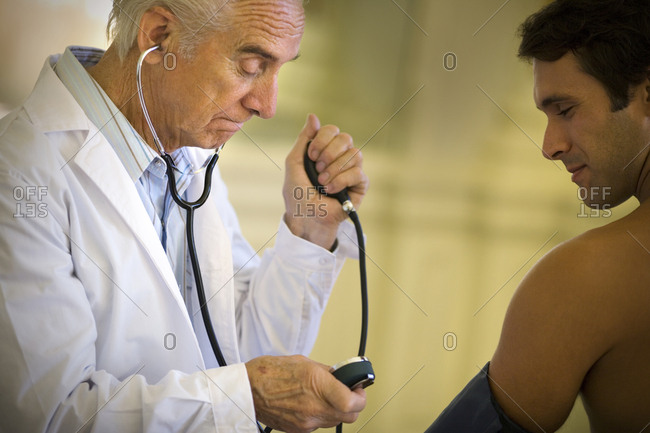 Doctor taking a patient's temperature