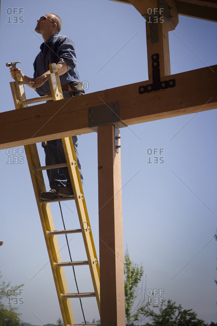 Builder at the top of a ladder