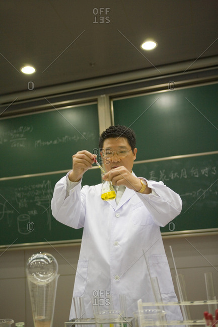 Science professor conducting an experiment