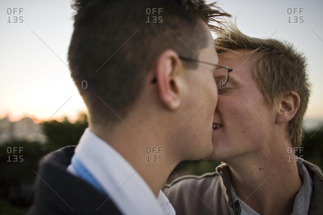Gay couple sharing a kiss