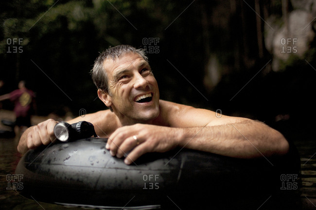 Man floating on a rubber ring in a cave