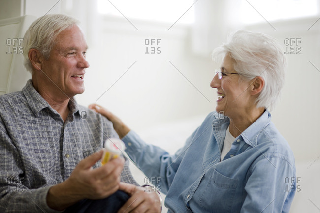 Senior couple discussing medication - Offset