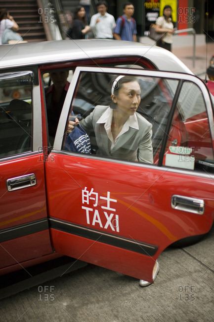 Businesswoman exiting a taxi