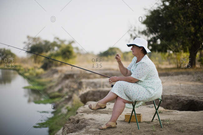 Woman fishing in a lake