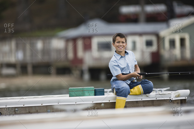Young boy fishing from a pier