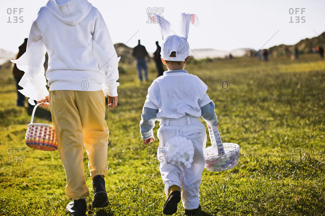 Two brothers on an Easter egg hunt