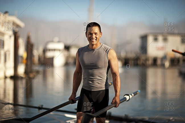 Rower standing at the water's edge
