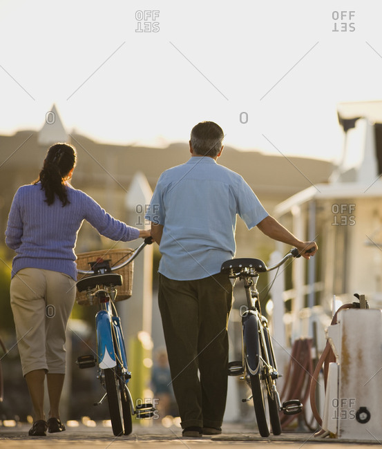 Couple walking with their bicycles