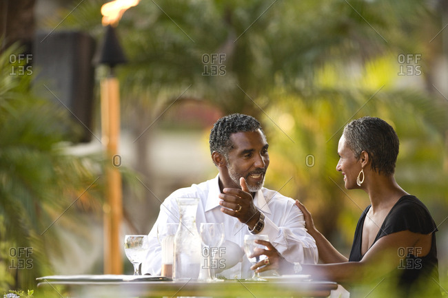 Couple enjoying a date at an outdoor restaurant