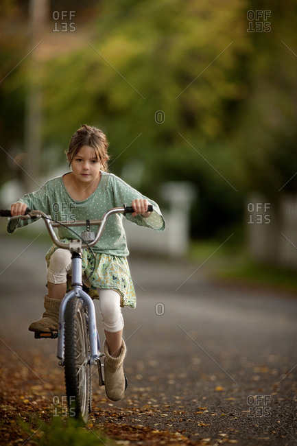 Young girl riding her bicycle