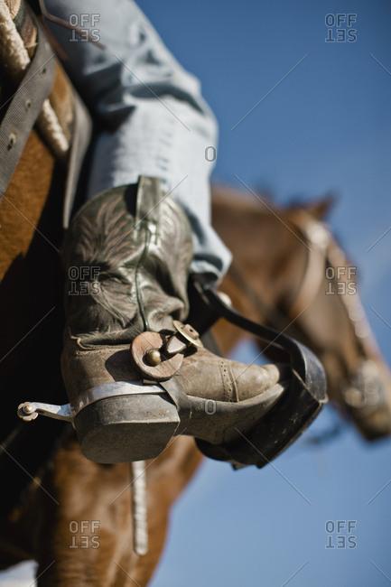 Boot of a cowboy on horseback