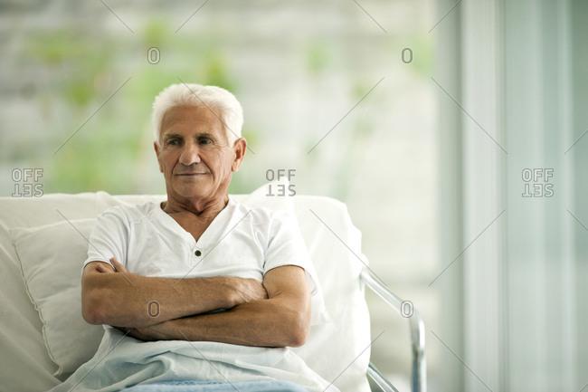 Senior man in a hospital bed