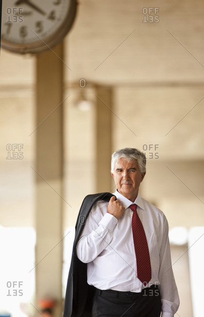Businessman waiting at a train station
