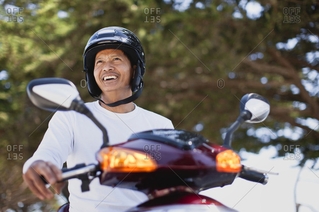 Smiling man on a scooter
