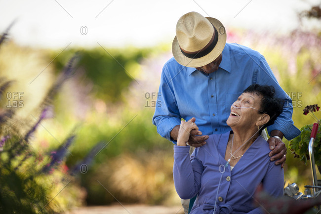 Senior couple with breathing apparatus spending time in their garden