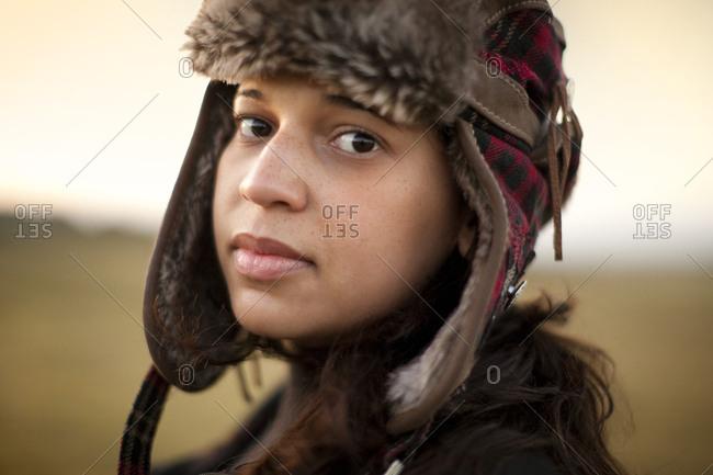 Young woman wearing a hunters cap