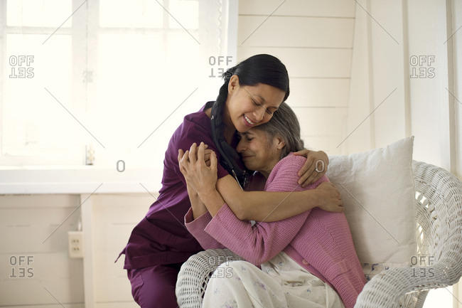 Nurse embracing a patient