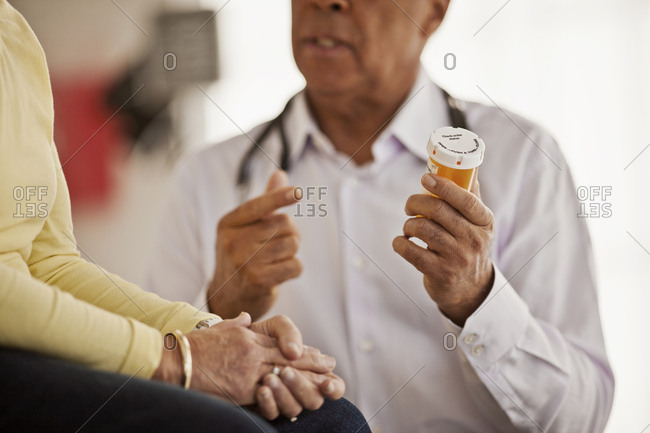Doctor explaining medication to a patient