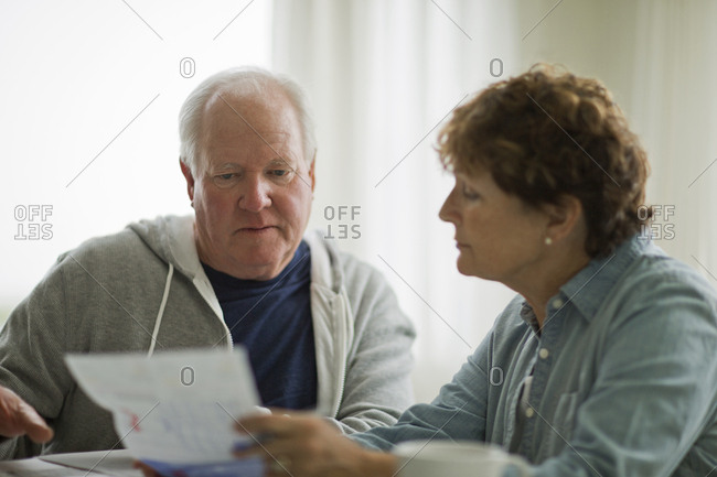 Senior couple looking over their finances