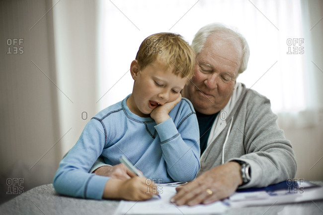 Grandfather helping his grandson with his homework