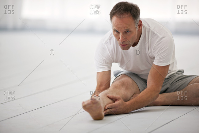 Man stretching during a yoga practice