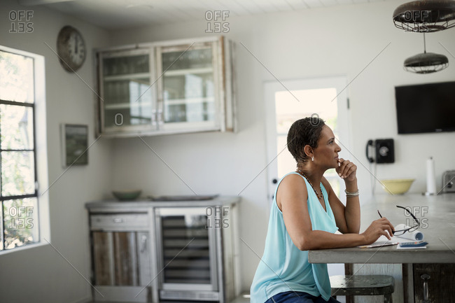 Woman working on home finances