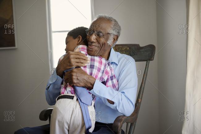 Senior man hugging his grandson