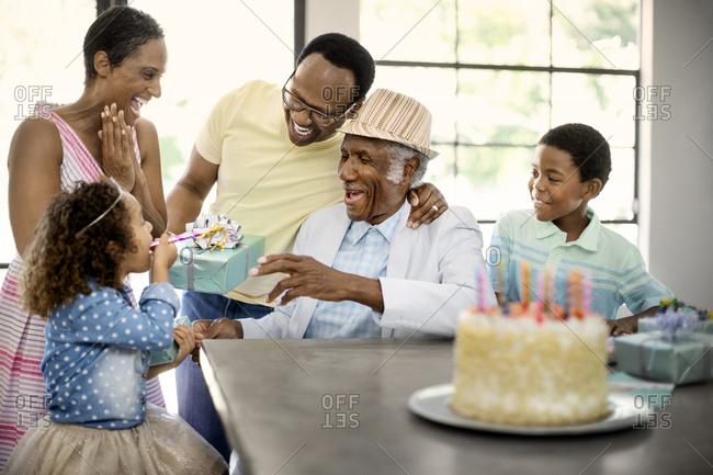 Senior man celebrating his birthday with his family