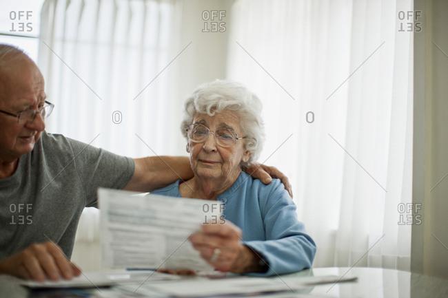 Senior couple examining their bills