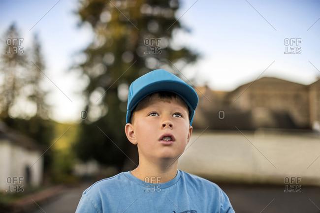 Young boy wearing a blue baseball cap