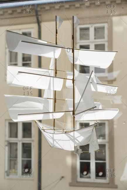 Copenhagen, Denmark - August 26, 2016: Sailing ship kite hanging in a window