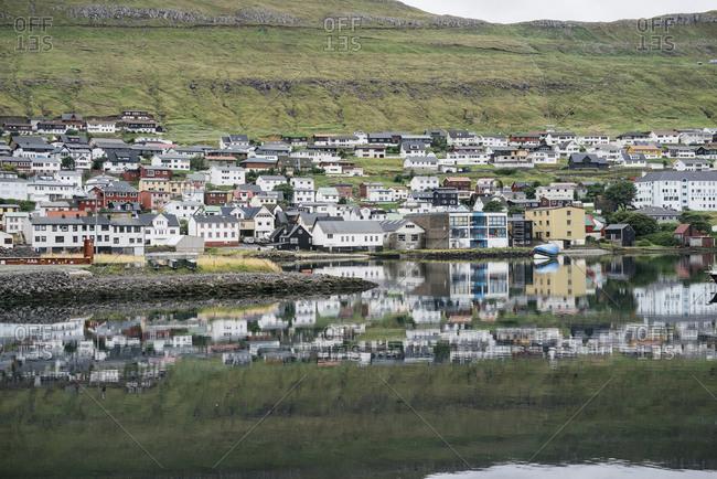 Faroe Islands, Denmark - August 28, 2016: Reflection in the ocean of village on the Faroe Islands