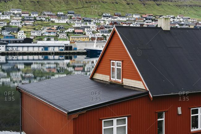 Faroe Islands, Denmark - August 28, 2016: Red house in a village on the Faroe Islands