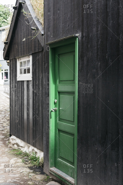 Black house with a green door
