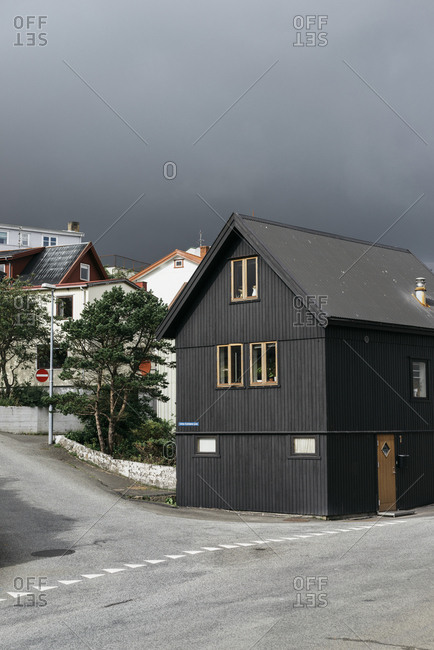 Dark clouds over houses in a village on the Faroe Islands